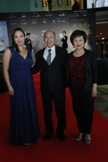 John Woo (centre) with his wife Annie Woo (right) and daughter Angeles Woo - photo by Bonnie Yap