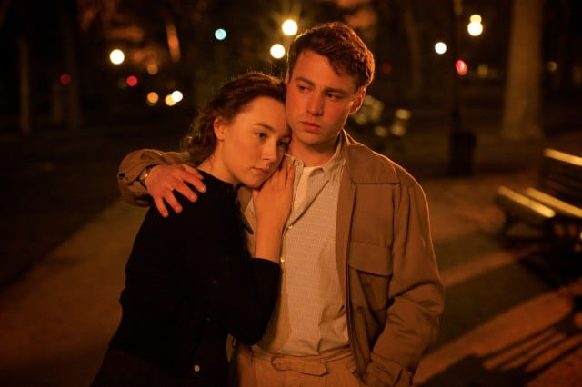 "Saoirse Ronan as ""Eilis"" and Emory Cohen as ""Tony"" in BROOKLYN. Photo by Kerry Brown. © 2015 Twentieth Century Fox Film Corporation All Rights Reserved"